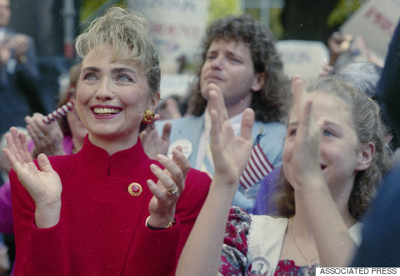 Hillary Rodham Clinton, wife of Democratic presidential hopeful Gov. Bill Clinton of Arkansas, and their daughter Chelsea applaud as the governor announces his intention to run for president, Oct. 3, 1991 in Little Rock. Roger Clinton, Gov. Clinton's brother, is in the background.