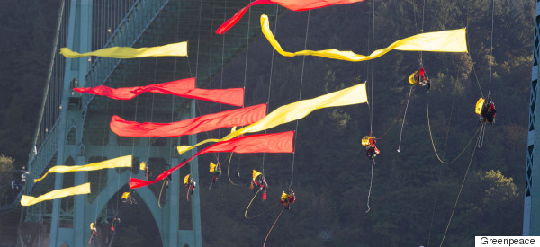 Incredible Pictures Of Activists Hanging From US Bridge To Stop Shell Ship Heading To Arctic For Oil