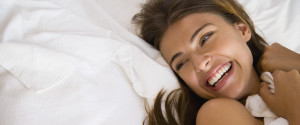 WOMAN HAPPY BED