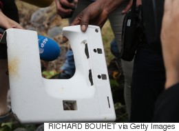 More MH370 Debris? Water Bottles And 'Plane Window' Wash Up On Reunion
