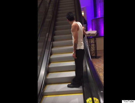 drunk guy escalator