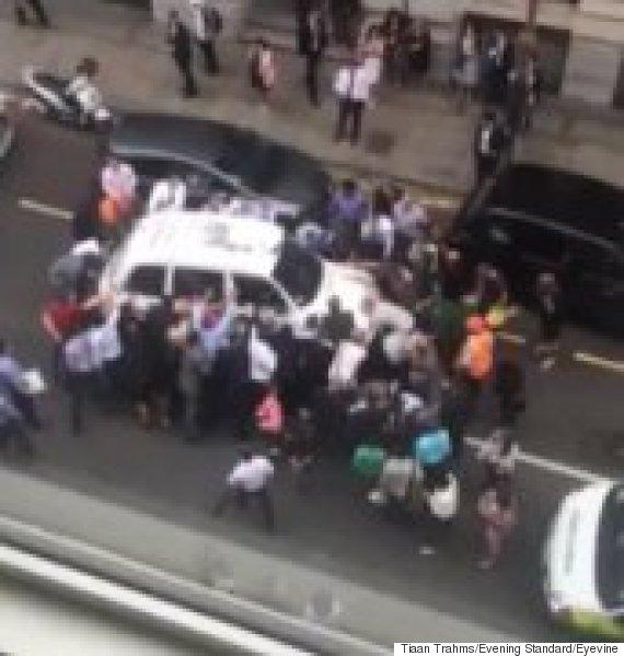 londoners lift cab off woman