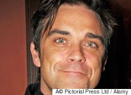 Robbie Williams Lied To Get Out Of Parents' Evening