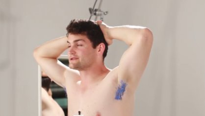 bored man bleaching his armpits