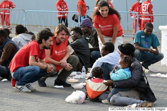 migrants smiling
