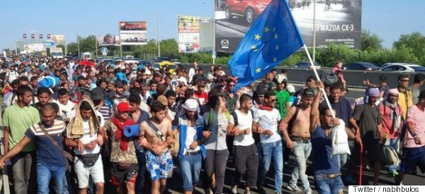 Poignant Scenes As Refugees March Hungarian Motorway To Reach Germany And Austria