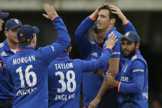 England players celebrate a wicket | Pic: AP
