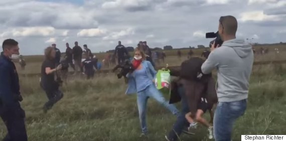 refugee tripped kicked