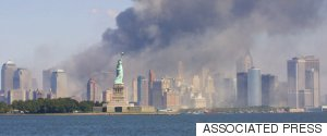 THE STATUE OF LIBERTY STANDS AS SMOKE BILLOWS