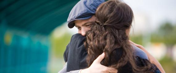 WOMAN MAN HUG SAD