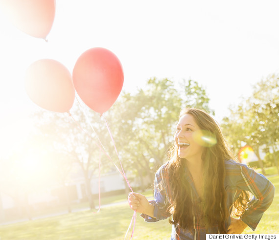 woman happy balloons