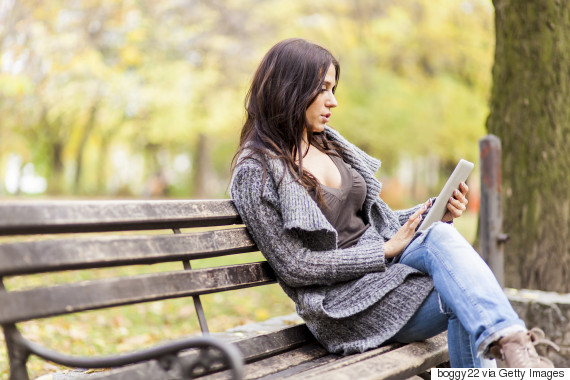young woman on bench in park