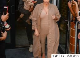 Kim Kardashian's Love Of Long Coats Knows No Limits