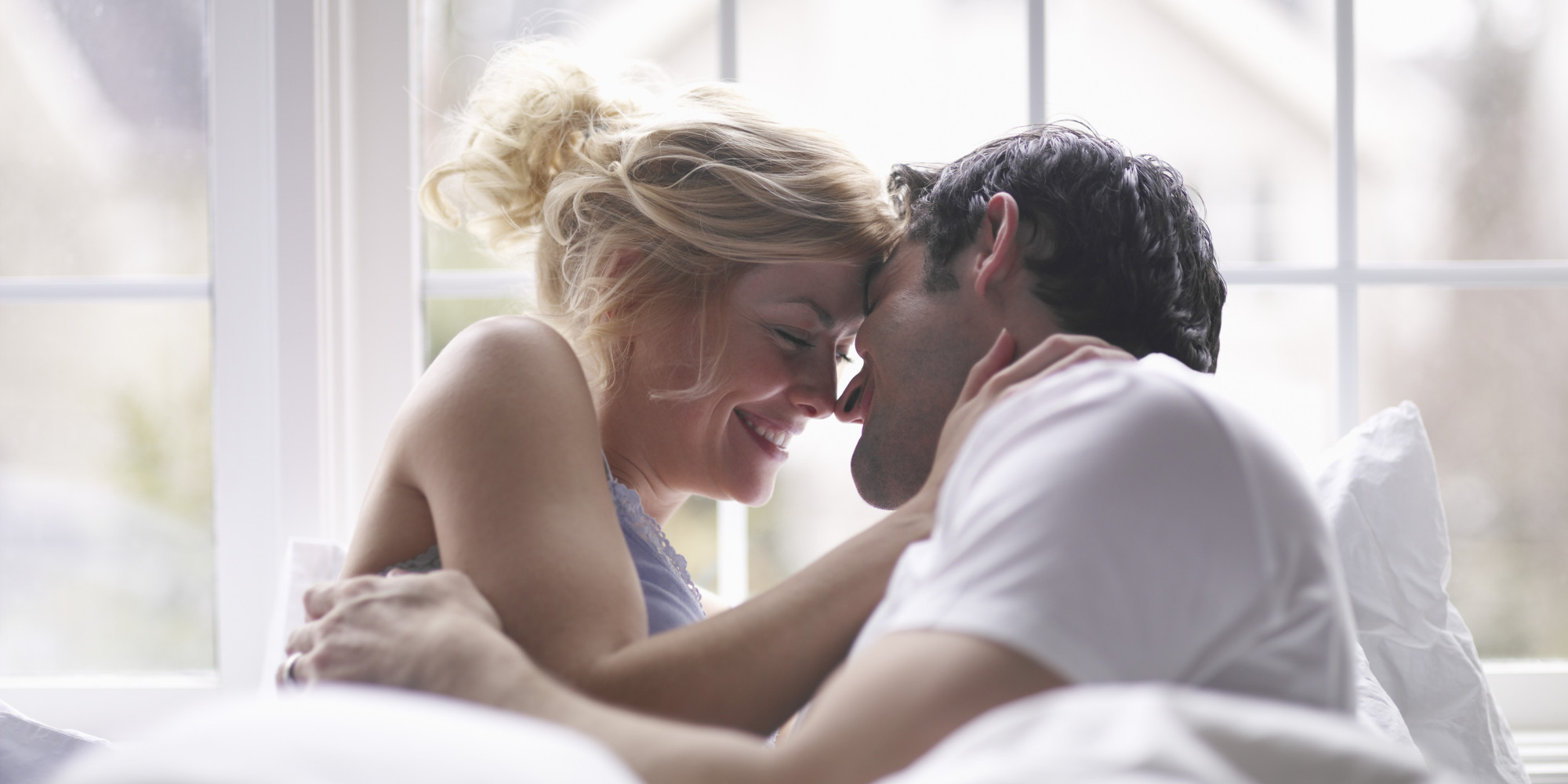 Lovely Couple In Bed Lying In Bedroom Men And Womens Ideal Number Of Sexual Partners Reveals Shocking