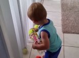 Tidy Toddler's Battle With Tennis Balls Proves Giving Up Is Never An Option