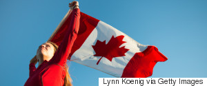 TEEN HOLDING CANADIAN FLAG