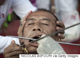 GRAPHIC IMAGES: Devotees Celebrate Vegetarian Festival By Piercing Their Faces With Swords