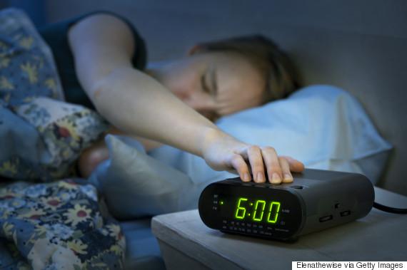 alarm clock tired