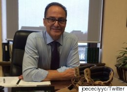 Joe Ceci Holds Up His Dad's Workboots As A Symbol Of New Budget