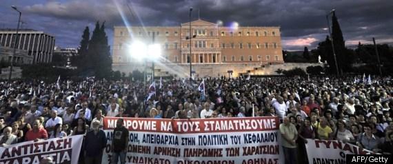 MOODYS DOWNGRADES GREEK BANKS