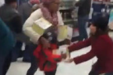 Woman grabs steamer from child | Pic: Youtube