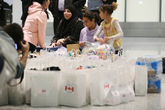 the arrival of syrian refugees to toronto airport