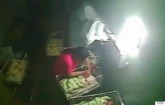 midwife bites baby