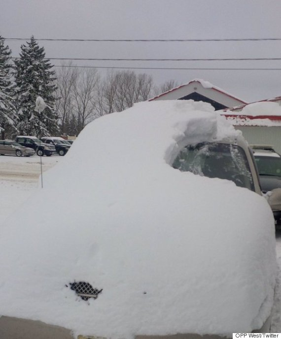 ontario snow covered car