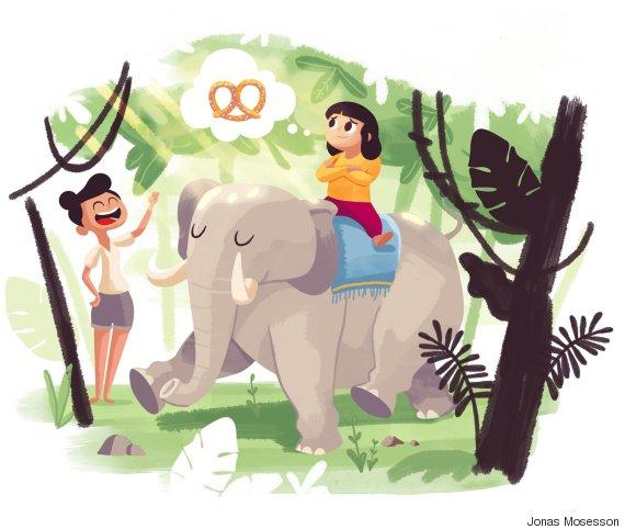 child riding elephant thinking of pretzels
