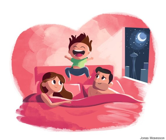 child jumping in bed with parents