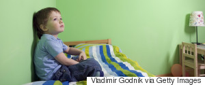 CHILD SITTING IN ROOM ALONE