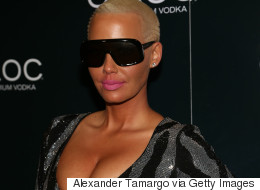 Amber Rose Blasts 'F***ing Clown' Ex, Kanye West