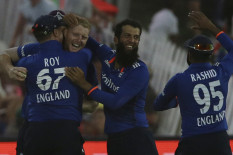 England players celebrate a wicket | Pic: PA