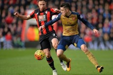 Bournemouth and Arsenal in action | Pic: PA