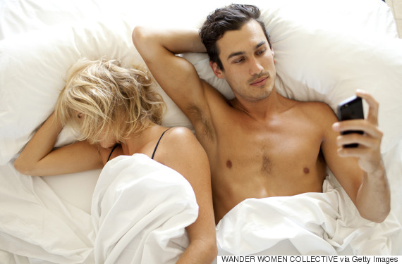 couple in bed phone