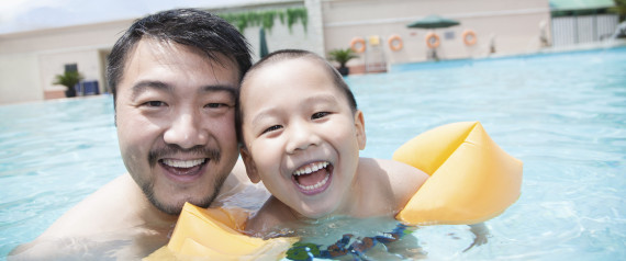 ASIAN FATHER CHILD SWIMMING
