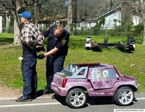 man arrested driving pink power wheels car