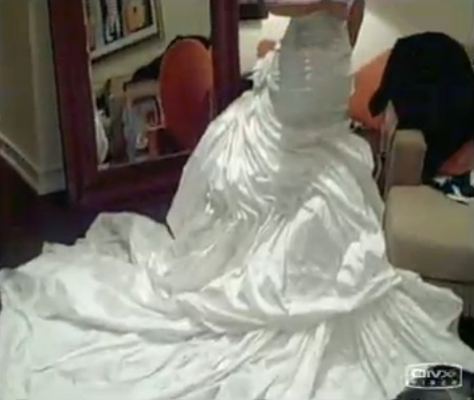 a shot of the singer trying on her strapless wedding gown back before the