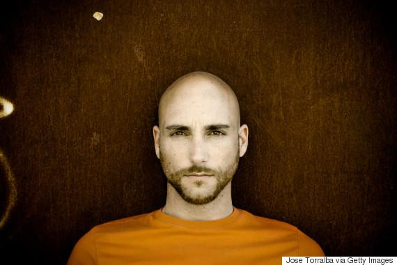 young bald man