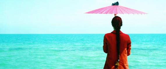 WOMAN COAT ON THE BEACH