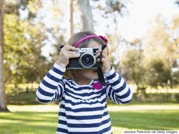 kid holding camera