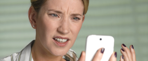 WOMAN SMARTPHONE FRUSTRATED