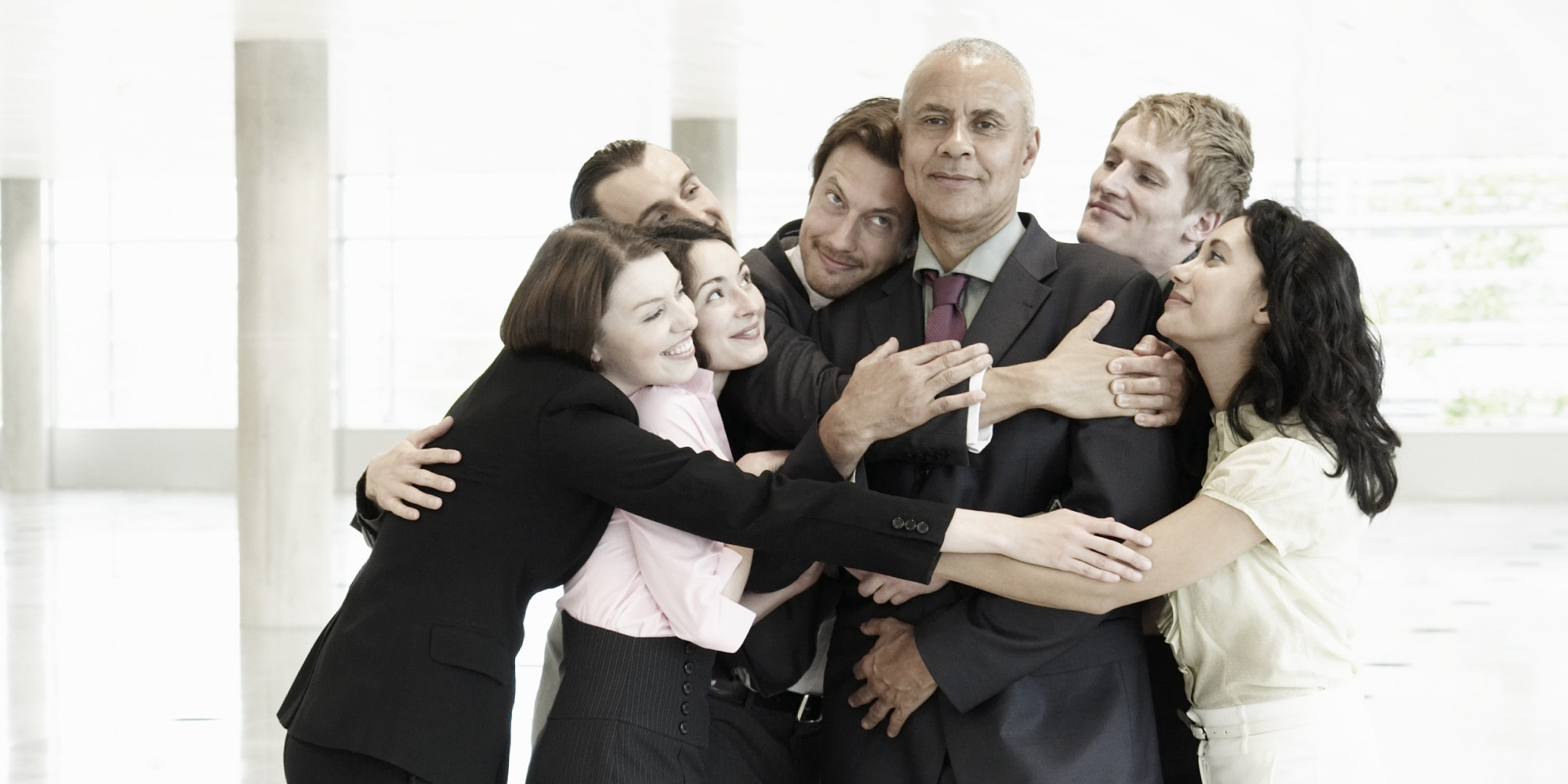 Team Building Event: Group Hug In Office Royalty Free ...