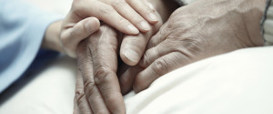 OLD PERSON HOLDING CAREGIVER HAND