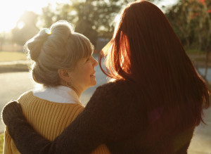 Older Mother Daughter Talking Sunlight