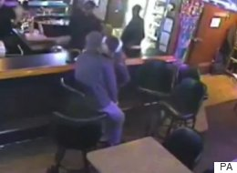 Oblivious To Armed Robbery, Couple Makes Out In Bar