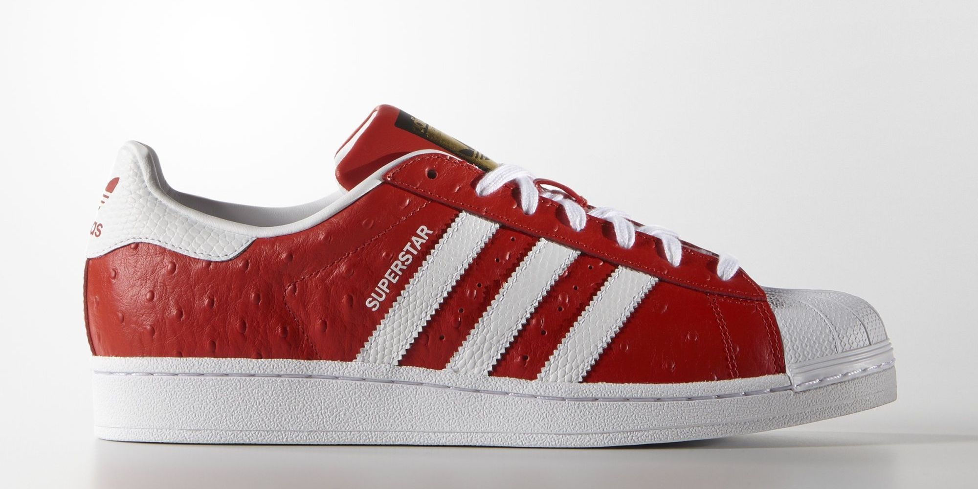 white leather adidas trainers on mummy