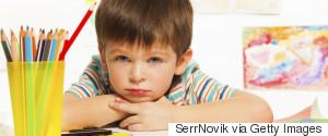 SAD YOUNG BOY AT SCHOOL