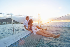Couple relaxing on boat | Pic: Getty Images