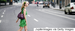 WOMAN WALKING SMILING CITY